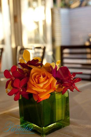 red and yellow orchids, yellow rose. Small and simple. $25.00