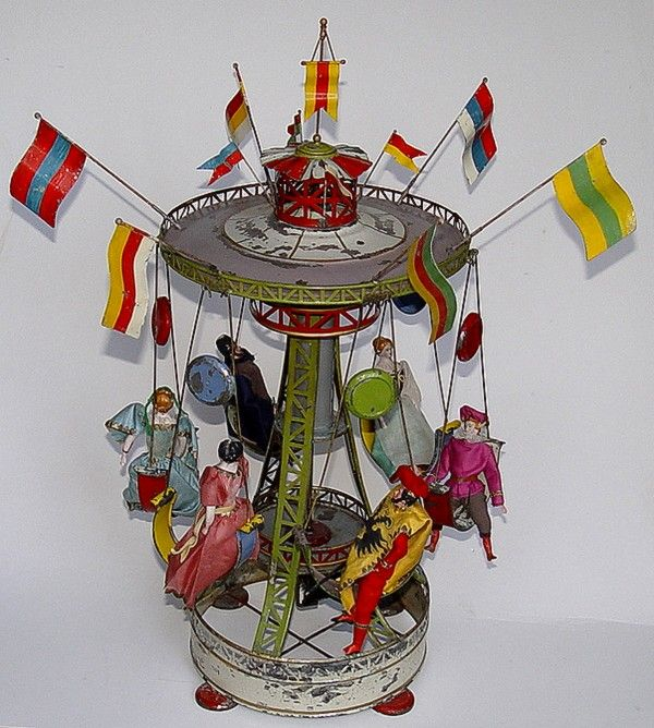 1895 antique tin toy carousel w/ bisque head dolls by Müller & Katheder.