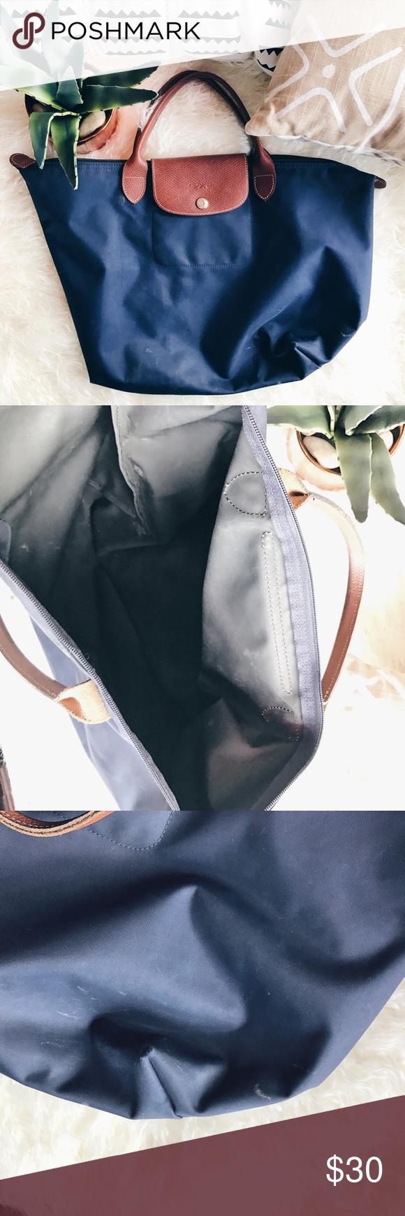 Long champ Handbag Navy Long champ handbag . Has a tiny hole on the side of the bag (picture below) Longchamp Bags