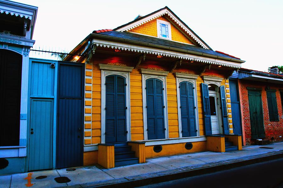 By: Ryan Burton Dusk shot of beautiful Creole Cottage on Dauphine street in the French Quarter in New Orleans Louisiana