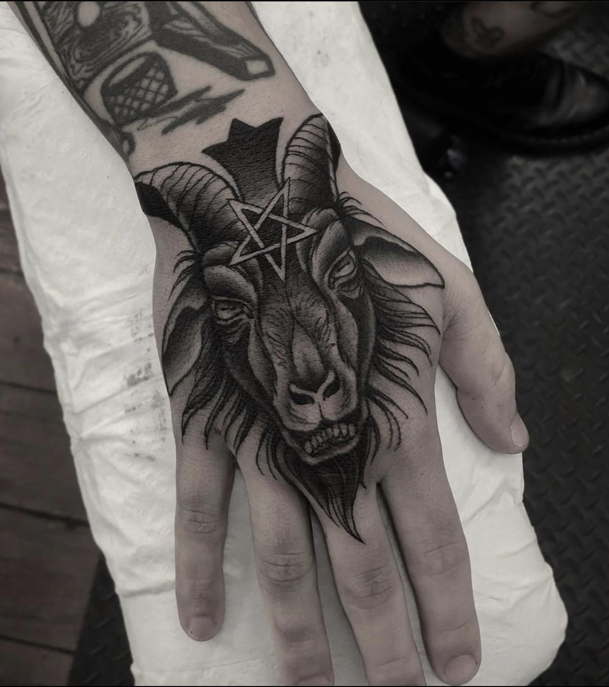 Baphomet hand tattoo done by Jayden seventh circle
