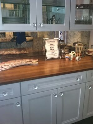 love the antiqued mirror backsplash w/ white cabinets & wood countertops. The Relished Roost: House Beautiful 2012 Kitchen of the Year.