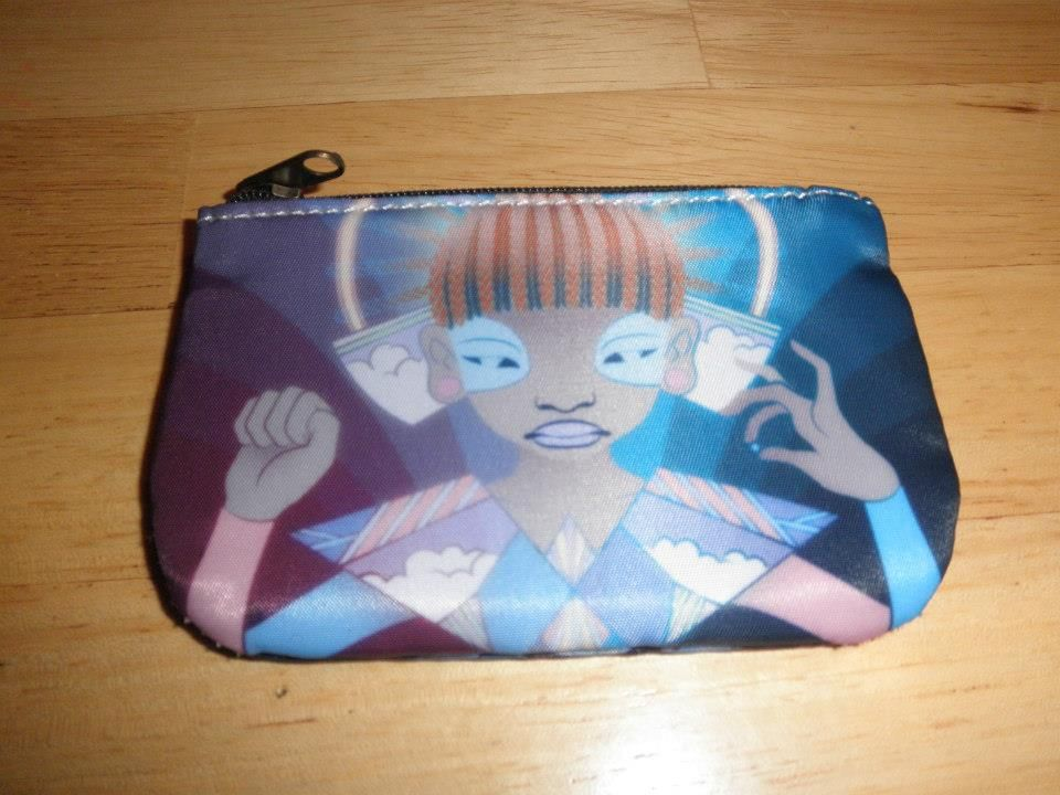 Coin purse design by Toujour Universe Artworks. Love her art and happy to be able to carry it with me. I keep my business cards in here so every time I take it out to give one I am sharing her works!