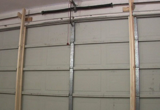 How To Protect A Garage Door From Storm Damage Today S Homeowner Garage Doors Garage Door Security Garage Door Design