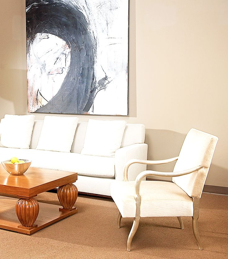 the Nelson Occasional chair shining in this image featuring the Rulhmann coffee table as well as the Jean Michel sofa.  #seating #sofa #furniture
