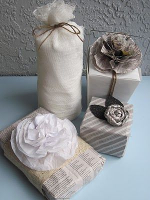 Pure and Simple: Cheese cloth bag tied with twine; Newspaper wrap topped with tissue paper flower; Newspaper flower on take-out box; Rolled newspaper rosette with felt leaves sprayed with glitter paint.