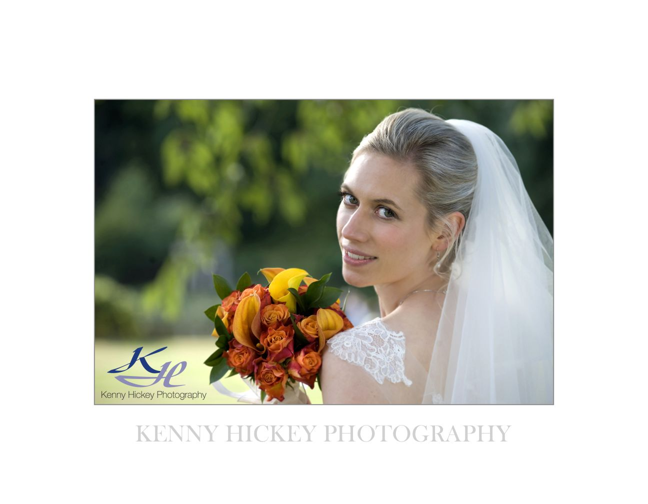 Beautiful smiling bride looking back with orange bouquet