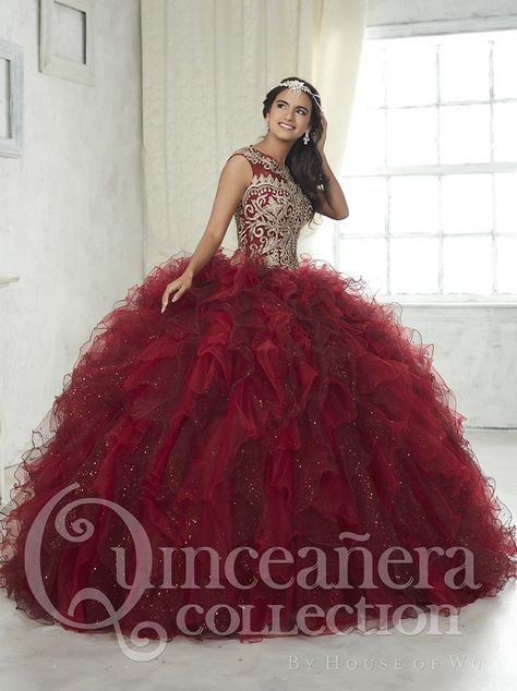 of Wu Quinceanera Dress Style 26835 Feel and look like a beautiful Princess in a House of Wu Quinceanera Dress Style Number 26835 during your Sweet 15 party or any formal event. This ball gown features glimmering embroidery dipped in go