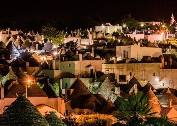 Alberobello, italy whose population is about 11,000, dates to at least the mid-14th century when it was colonized by the Count of Conversano. The town's distinguishing feature is its trulli, cone-shaped dwellings made from limestone.