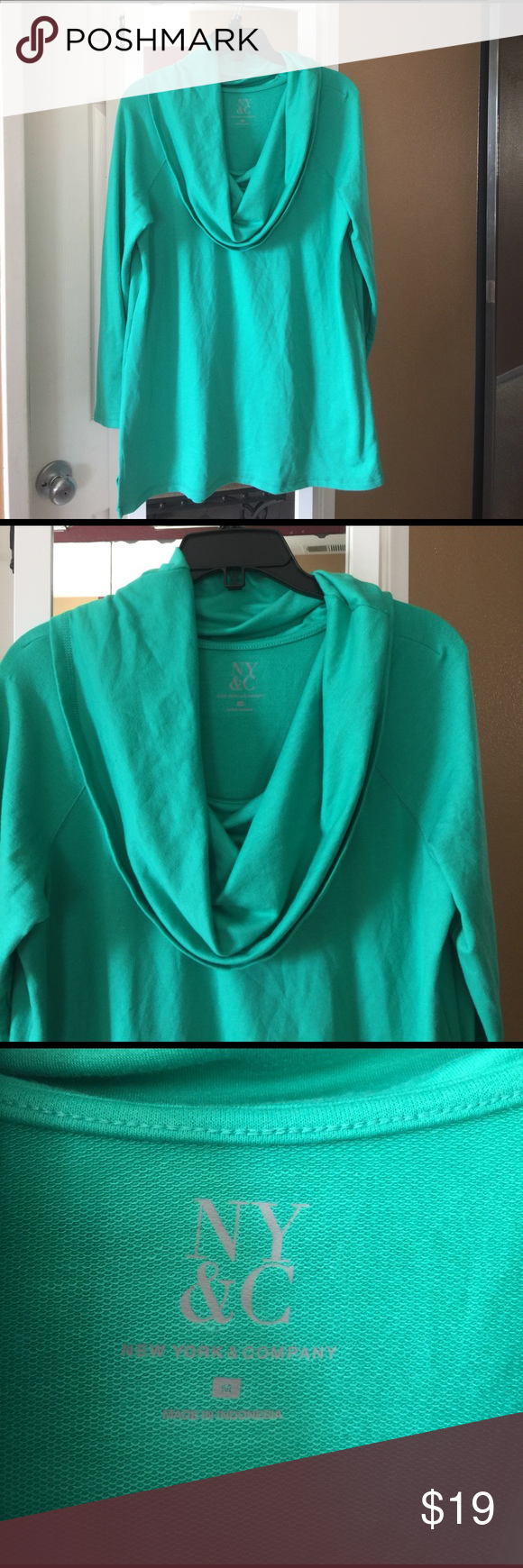 Green sweater New York & company light Green cowl neck sweater. Size marked medium but it's over size, more like XL or size 12. Material is soft and stretchy. Never been worn but no tag. New York & Company Sweaters Cowl & Turtlenecks