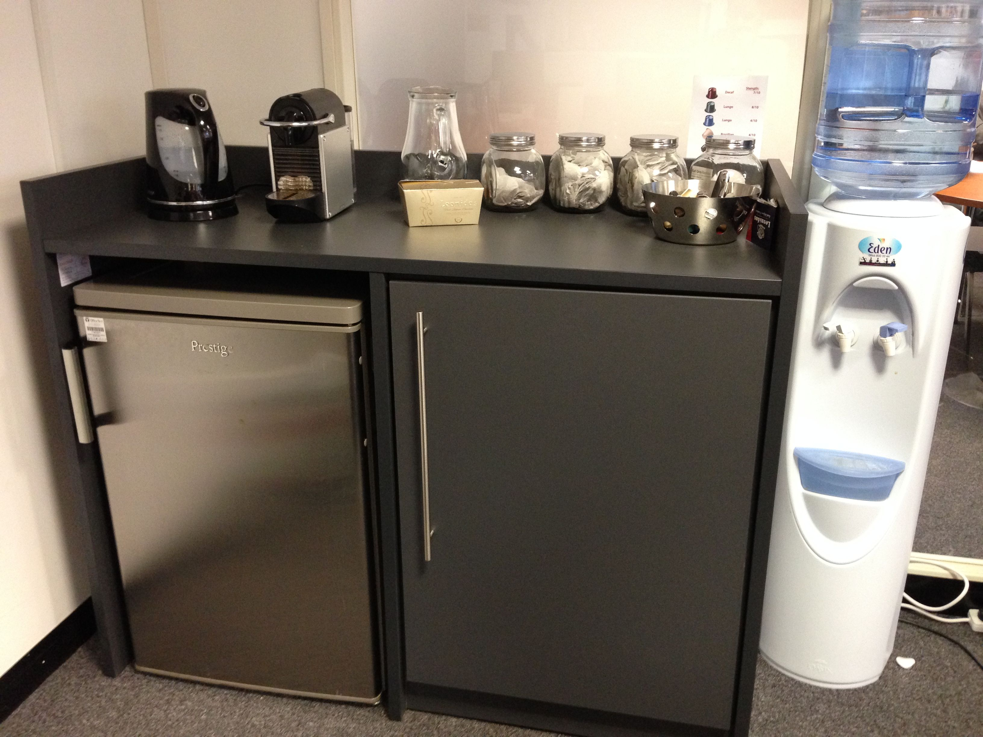 Small coffee point with single door storage in grey with stainless