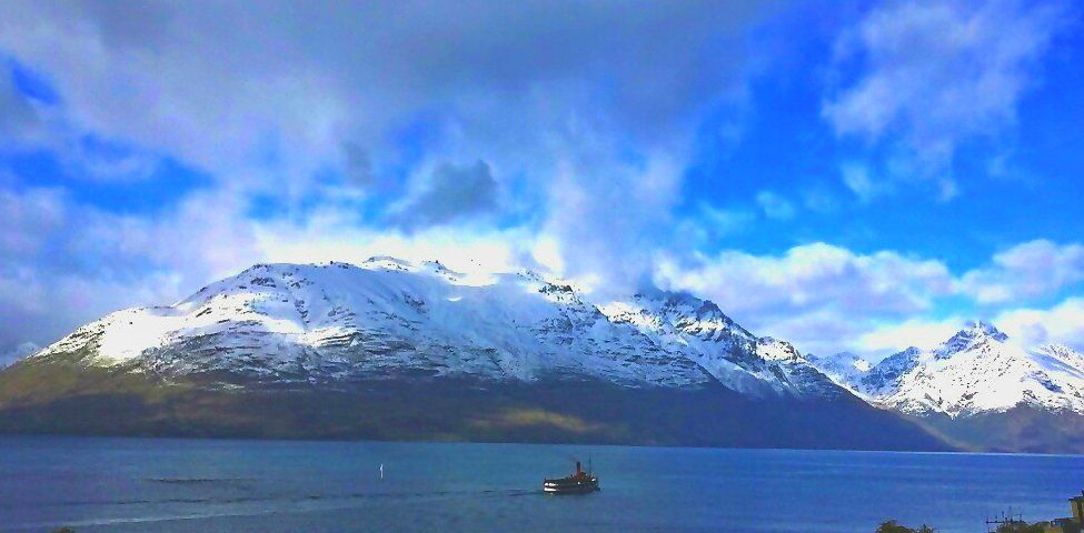 The Earnslaw boat heading towards the snow capped mountains #Queenstown