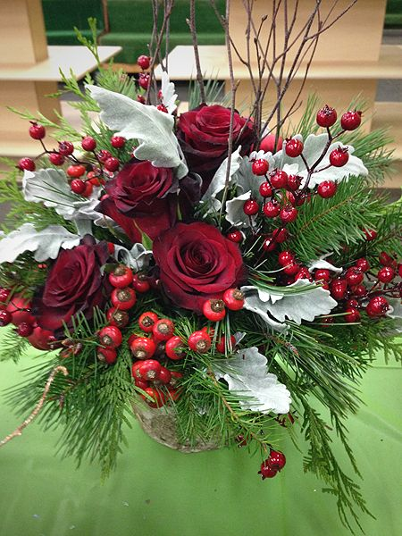 Christmas Arrangement With Greens Dusty Miller Red Roses Rosehips And Berry P Christmas Flower Arrangements Christmas Flowers Christmas Floral Arrangements