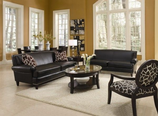 living room with leather furniture sets and decorative accent