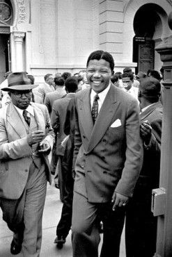 On October 13th 1958, at the Treason Trial, Moses Kotane and Nelson Mandela leave the Pretoria Court, a converted synagogue, beaming with joy as the Crown had withdrawn the indictment.However, on 19th January 1959, Nelson Mandela and 29 others, were put on trial again, but 2 years later weree found not guilty.