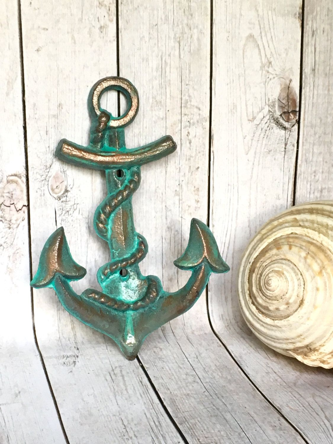 Anchor wall decor - wall hook in a water worn, copper patina finish. Hand painted turquoise and accented with a copper metallic glaze.
