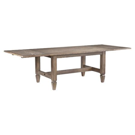 Extendable Wood Trestle Table With An Aged Patina Finish