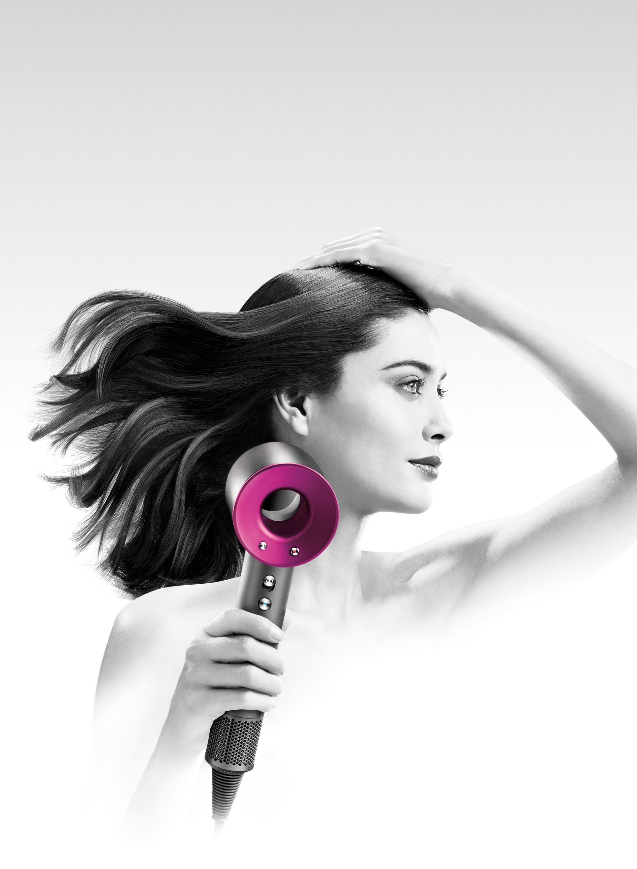 Model with Dyson Supersonic™ hair dryer Hair dryer