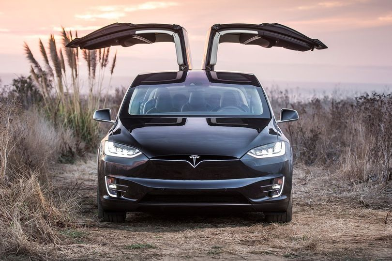 Tesla Model X Review Electric Car Scores On The Doors Tesla Model X Tesla Model Tesla X