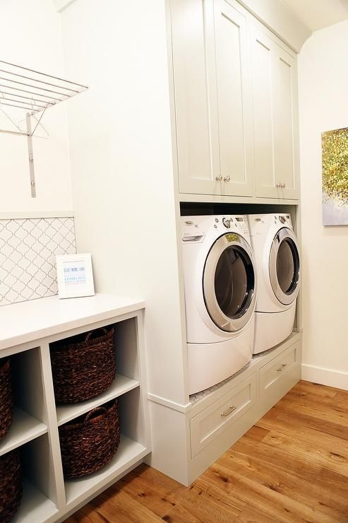 Fabulous Laundry Room Boasts A Built In Riser With Drawers Lined With A White Front