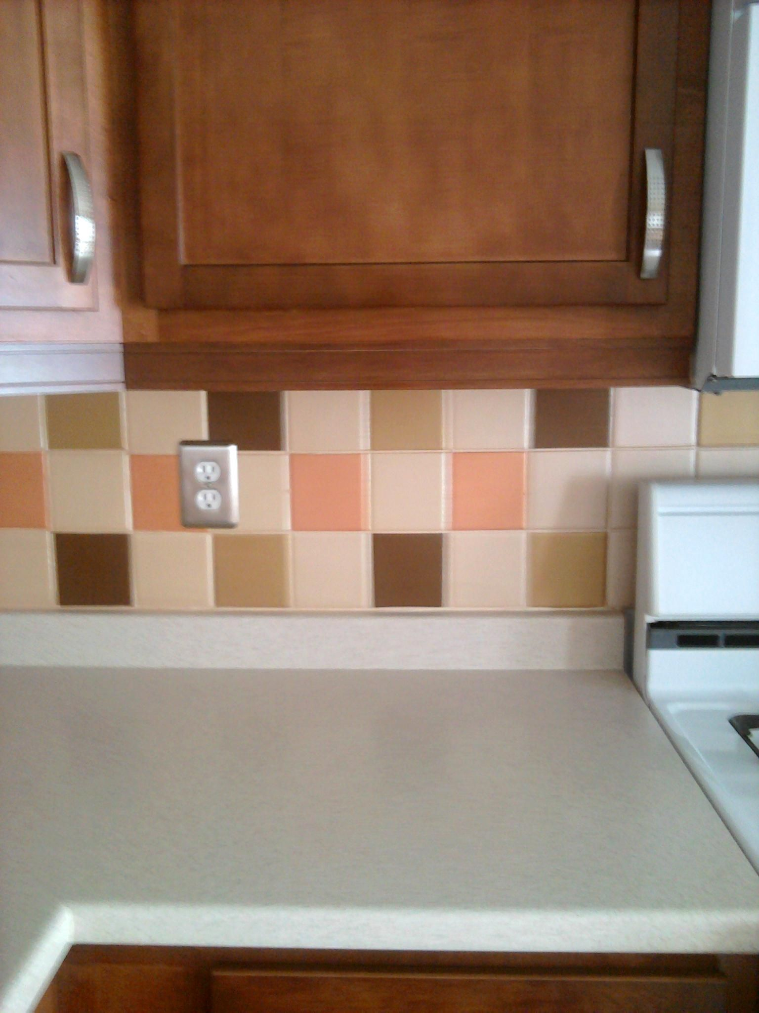 Hate your ceramic tile backsplash in your kitchen paint it see my