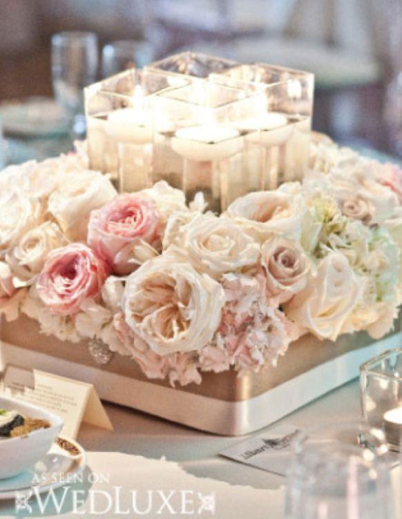 Short wedding reception centerpiece with light pink roses