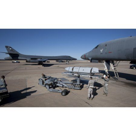 Weapons loaders prepare to load an AGM-158 Jassm onto a B-1 bomber Canvas Art - High-G ProductionsStocktrek Images (19 x 11)
