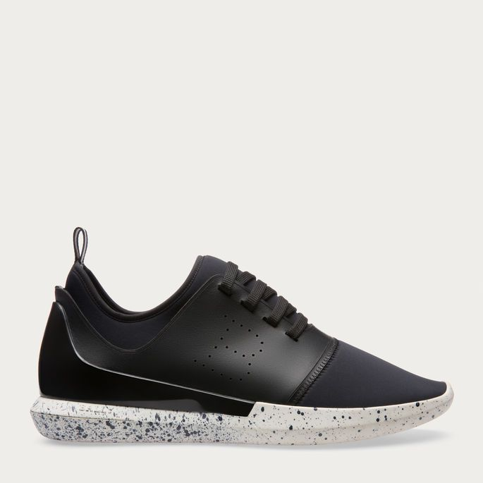 Shop the Avro sneaker from Bally. This unique new-season sneaker is formed  from neoprene and leather sitting on a distinctive flecked rubber sole.