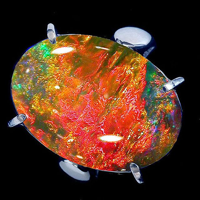 Part 5 (Red) of our Fifty Shades of Color blog series. In this post, you'll get an overview of the gorgeous different shades of red you might come across in boulder opals, our favorite gemstone! | #opal #jewelry