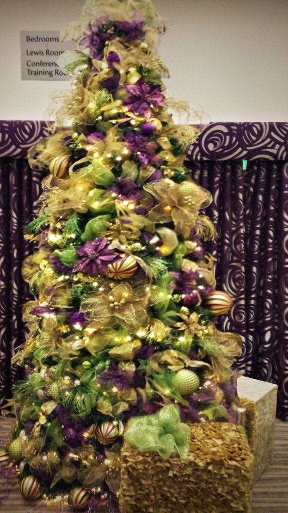 Green and purple Christmas trees for hire. Our green and