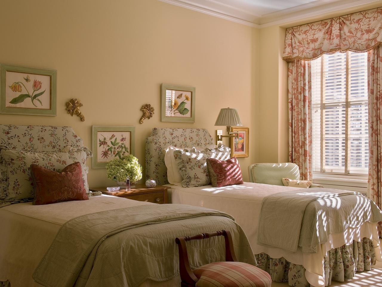 The sunny, countrystyle guest bedroom is painted with