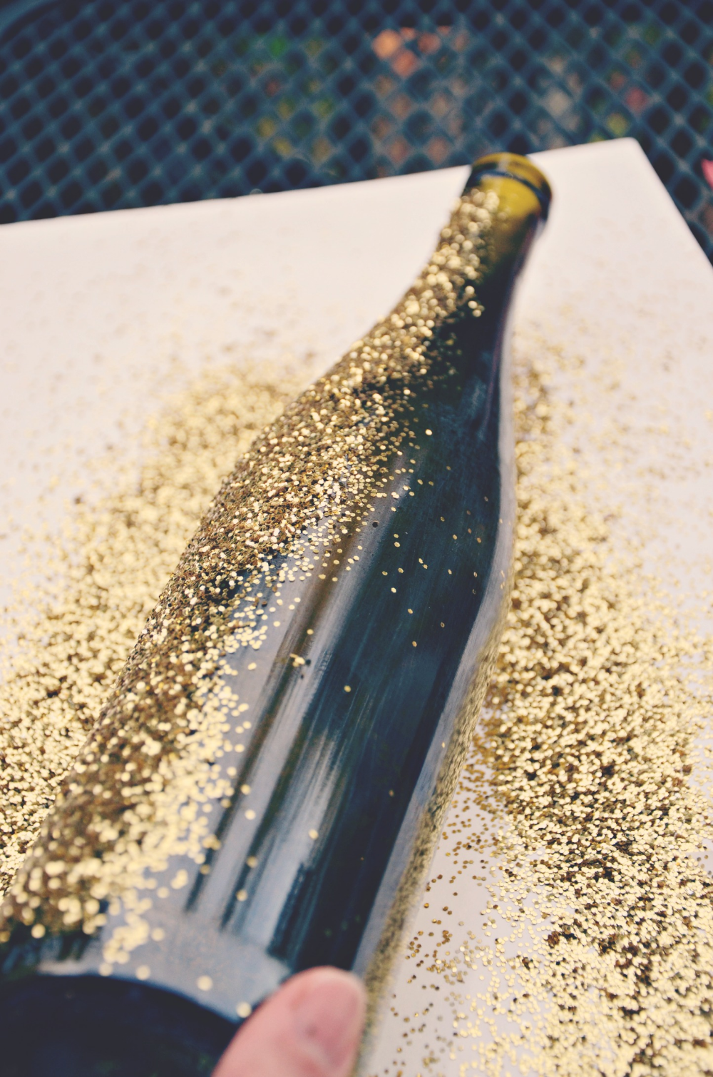 Tutorial for DIY Glittered Wine Bottles is part of Glitter wine bottles, Glitter wine, Wine bottle diy, Wine bottle diy crafts, Wine bottle crafts, Bottle crafts - Getting glittered wine bottles is as easy as 1, 2, 3! In a few easy steps, anyone can glitterup a wine bottle  This method also works for other glass too!