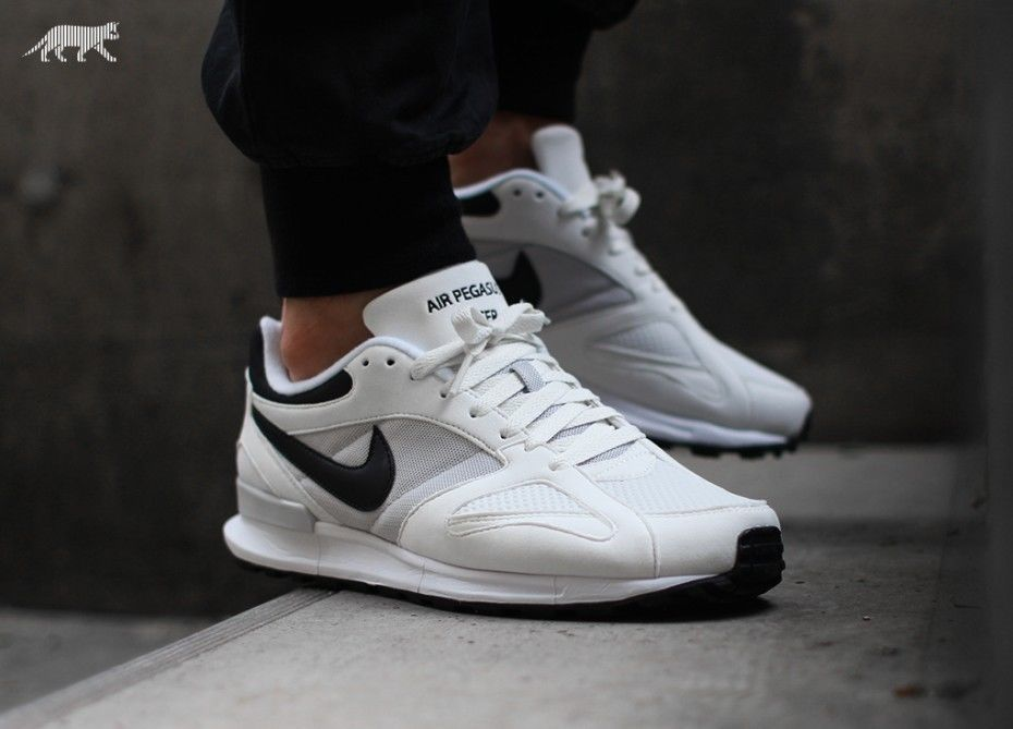 Buy Nike White Leather Solid Sports Shoes online