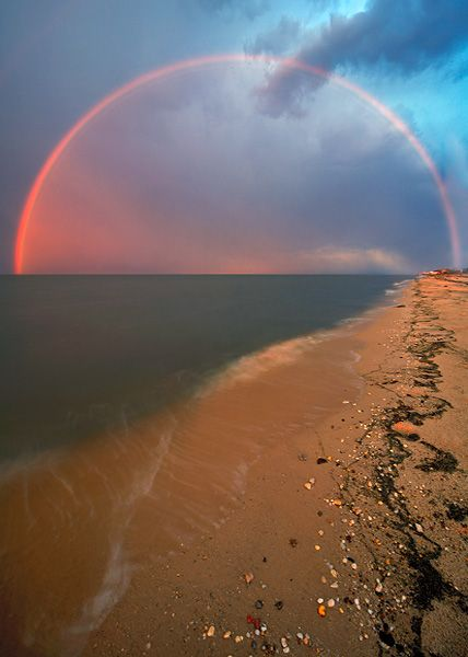 A 14mm lens was used to capture the entire arc of a sunset rainbow over Big Stone Beach, Delaware Bay.