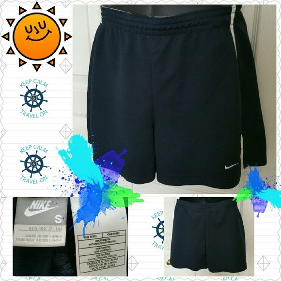 "Nike navy blue shorts, size S, EUC Nike navy blue shorts with a white stripe on each side.  Size Small, 100% poly.  Waist is 28"" as is & up to 32"" with elastic.  Can be made smaller than 28"" by using drawstring embedded in the elastic.  Front rise is 11.5"", back rise 15"", inseam 3.75"", length 13.5"".  Worn twice, EUC. Nike Shorts"