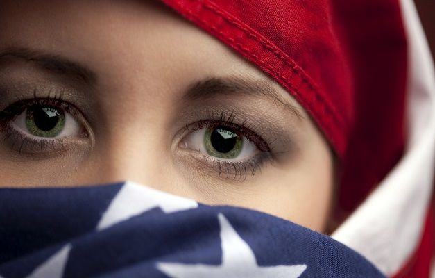 Muslim Girl USA Flag Hijab  Important read.  Why we as a nation have to stop Muslim immigration.  I understand that not all are terrorists; but if they follow Mohammed they are a danger to us.  Toleration is fine until they declare war on us.  Then we are being fools.