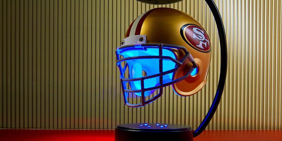 Hovering lit up football helmet for your favorite team