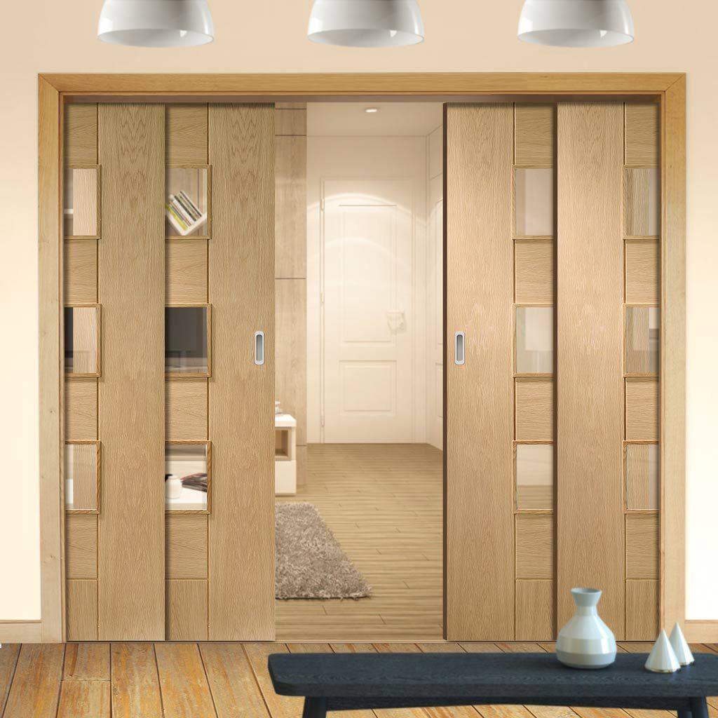 Quad Telescopic Pocket Messina Oak Veneer Door - Clear Glass - Prefinished.    #glazeddoors #interiordoors #telescopicdoors #pocketdoors #hiddendoors #doors #interiordesign