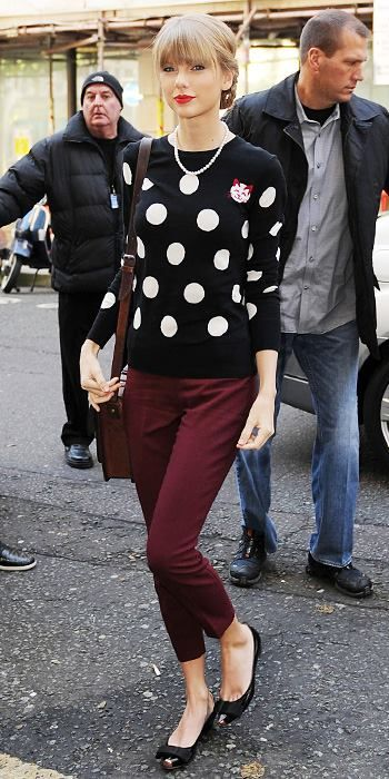 I love this sweater! Even though it has a cat on it. Taylor has a fun style! She is growing on me! :)