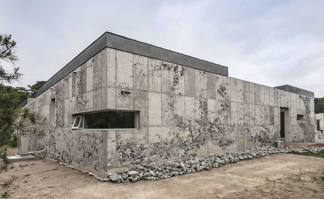 Set in Stone: Archium's Roughly Hewn Sculpture Gallery Lets Nature Flood In - Architizer