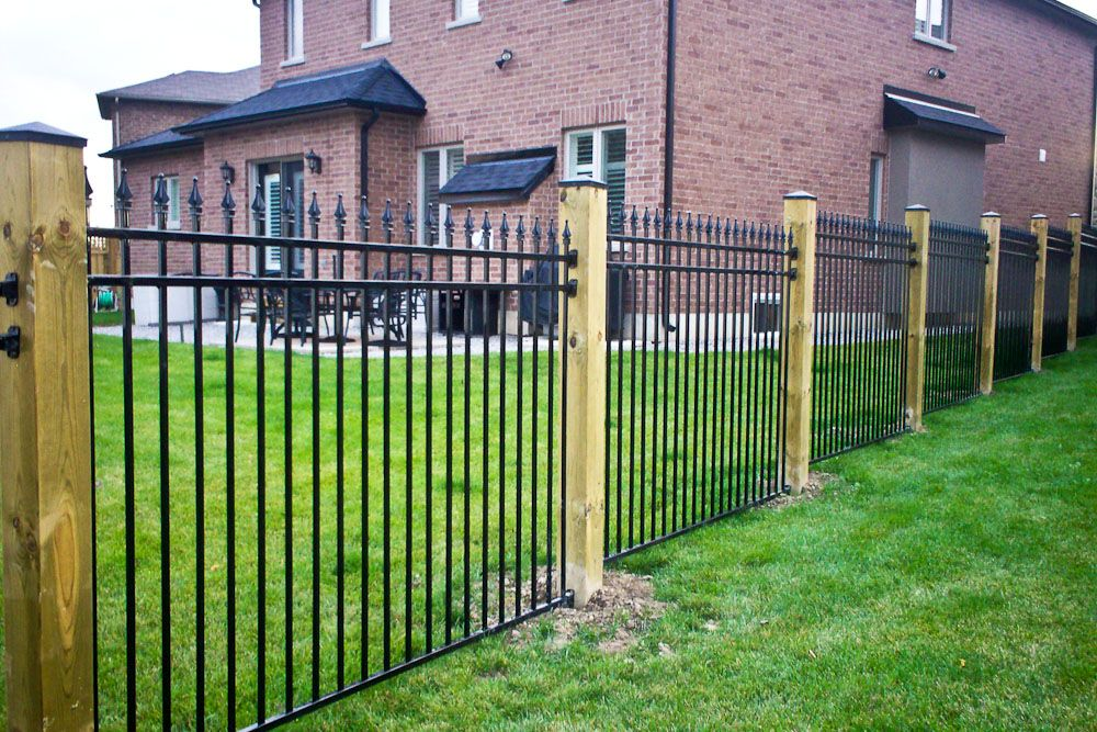 Spike Topped Metal Fence With Wood Posts Metal Fence Fence Design Fence Landscaping