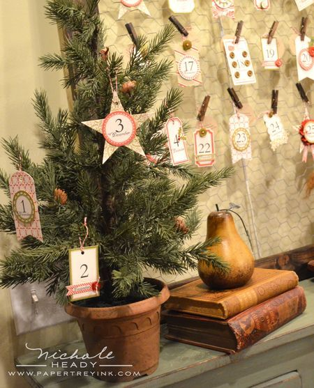 Countdown to Christmas, love the wire frame with pinned tags! On the back of each tag is an activity to do!