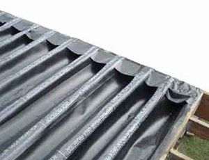 Low Cost Deck Drainage Landscape Membrane And Off The Shelf Gutters Keep The Space Below New And Existing Decks Dry Building A Deck Diy Deck Deck Building Cost