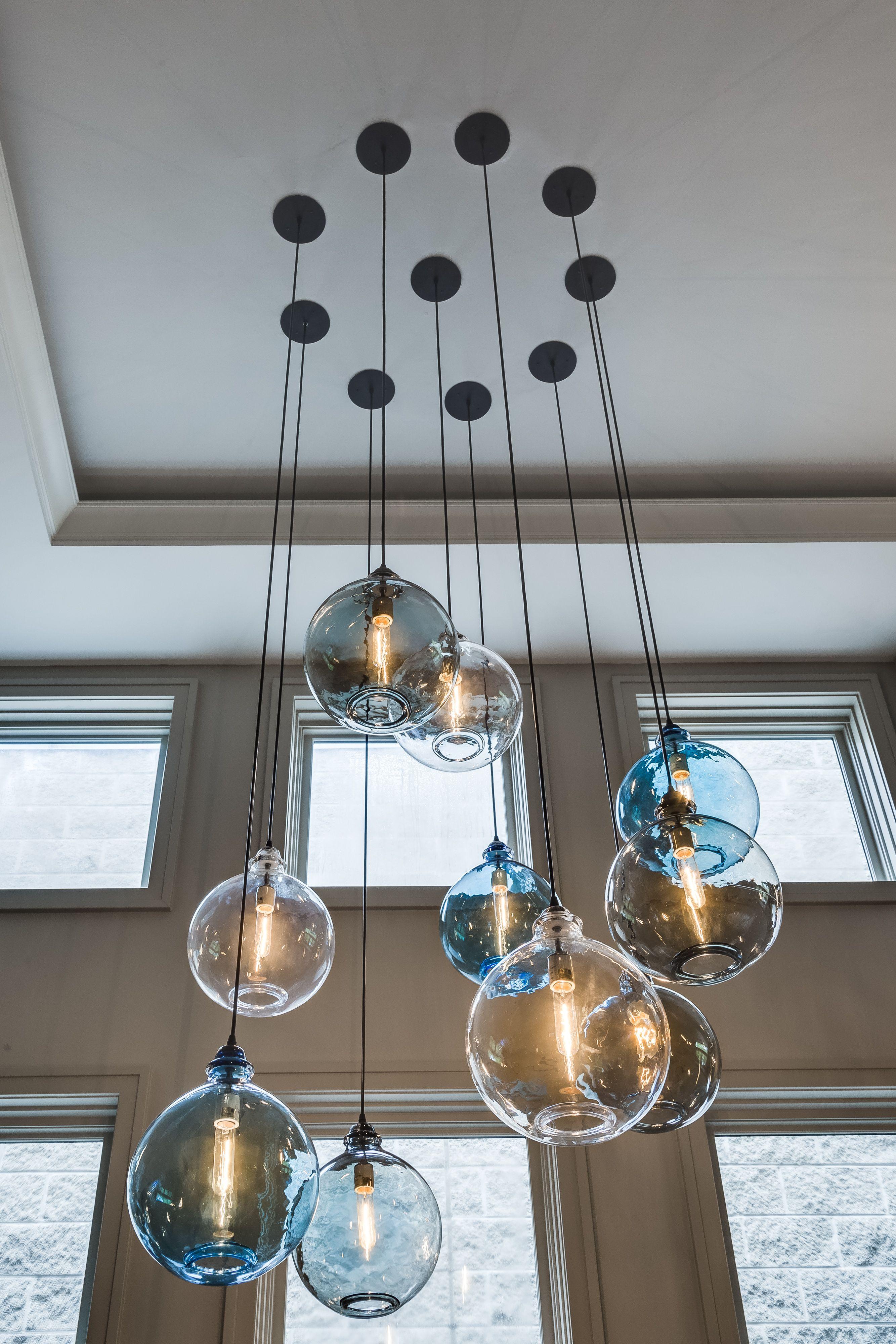 Salon-spiegel-designs urban parlor living room with globe lighting multi light pendant