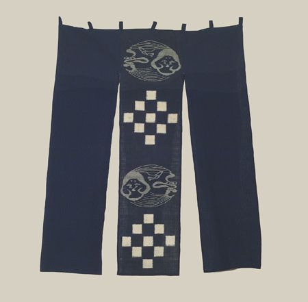 """Ikat Noren, Early Showa era (1926-1940), A noren created with an older center strip that features """"kasuri"""" (double-ikat) work: the """"Okami"""" (funny lady) motif is unusual. The two flanking indigo plain strips are not as old as the early-Showa central strip, so evidently this noren was created perhaps mid-20thc or later.  36"""" x 47"""".  Yorke Antique Textiles"""