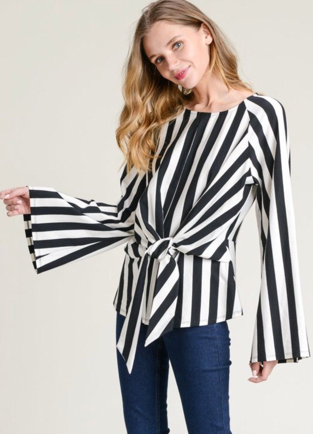038fcda11586f Striped top with wide long sleeves and a torso wrap tie feature ...