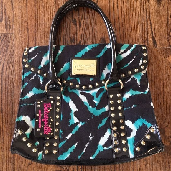 Betsey Johnson Handbag Studded and printed Betsy Johnson handbag. Magnetic closure. Studs around the edges. In great condition. Betsey Johnson Bags Totes