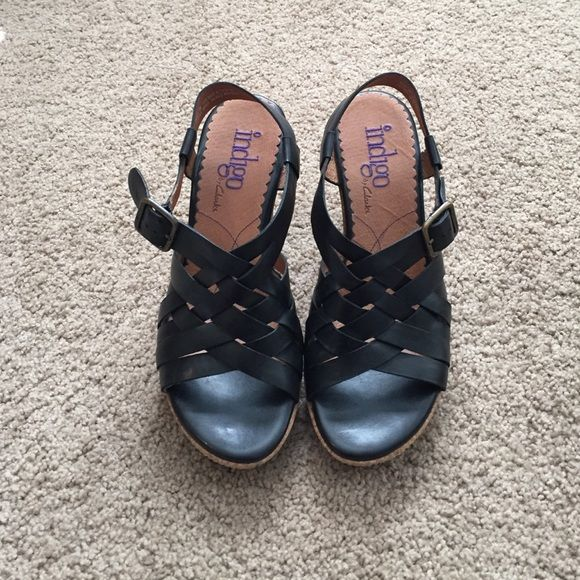 Clarks wedges Clarks black criss cross strapped sandal wedges with cork bottom!! Only worn a few times❤️ Clarks Shoes Wedges