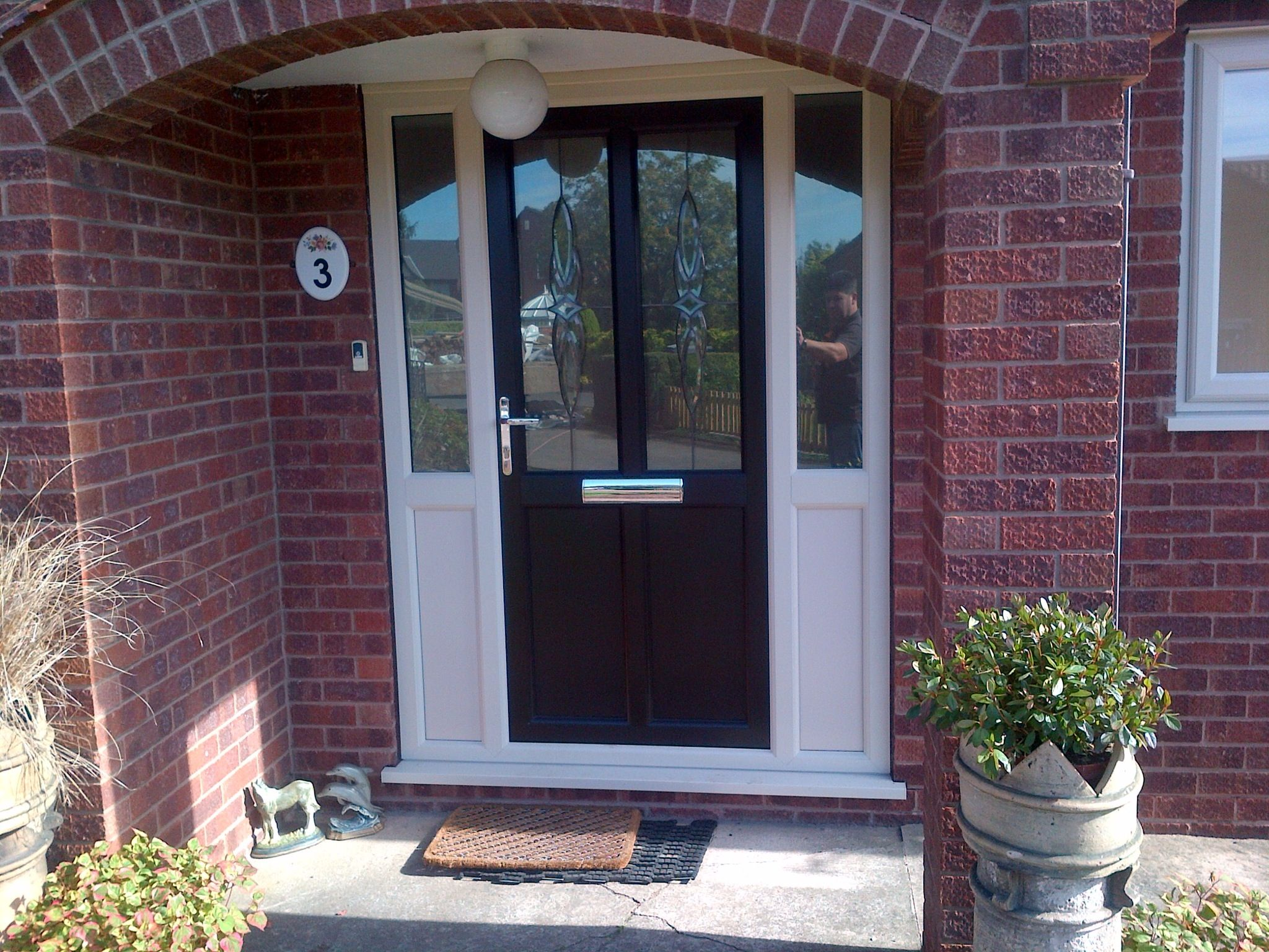 Upvc door in rosewood with white side panels https for Front door and side panel