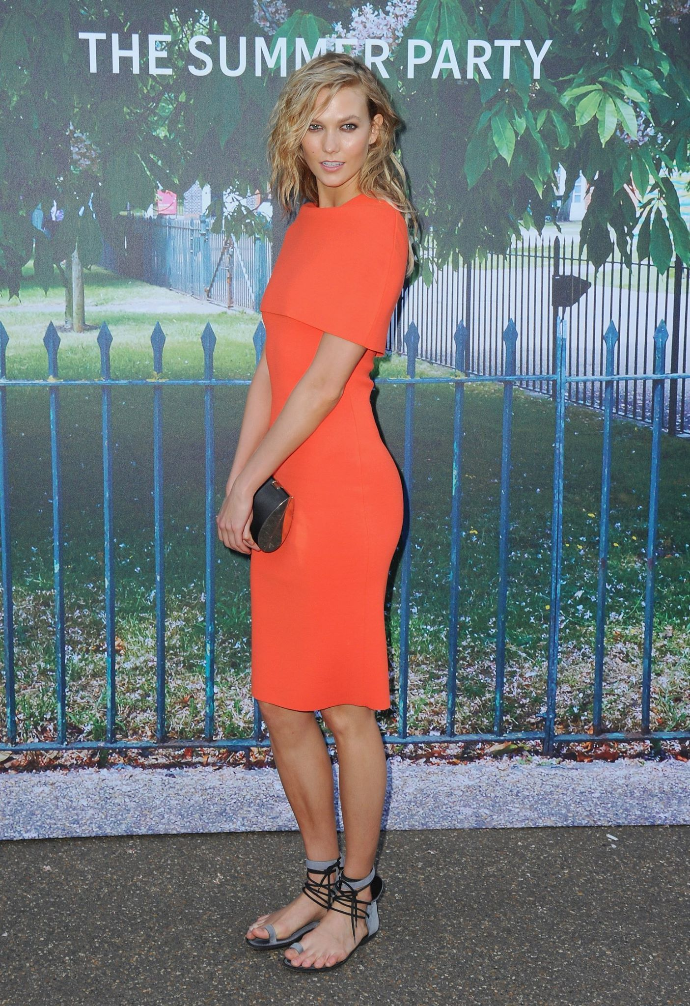 2f3b5b1f21c5b Karlie Kloss sizzles in a hot coral Stella McCartney midi dress paired with  strappy flats at the #SerpentineSummerParty. | Get the look at shopstyle.com